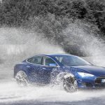 Tesla Model S drifting in water