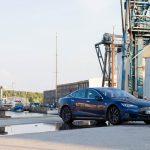 Model S in port Neustadt in Holstein Buiilding in Background