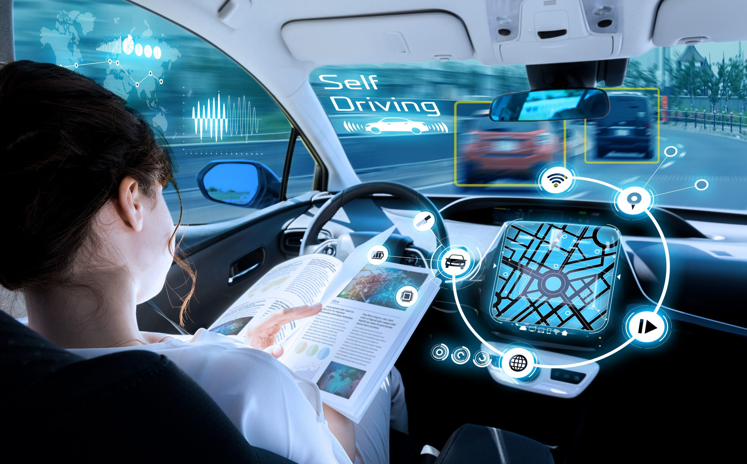 young woman reading book autonomous car